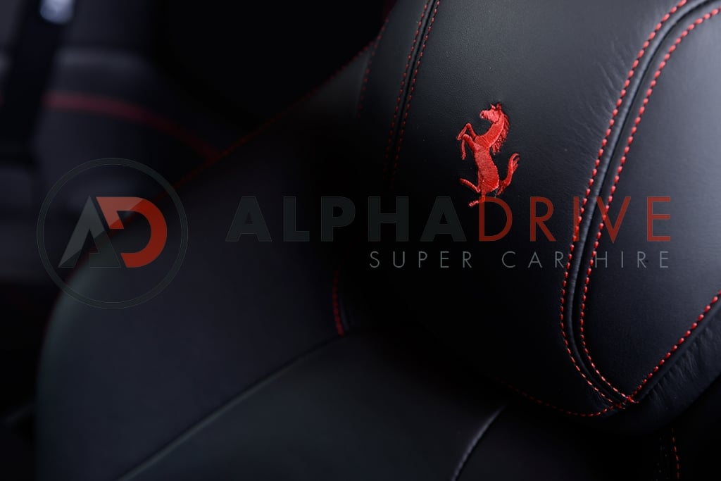 Ferrari red stitching seats car hire