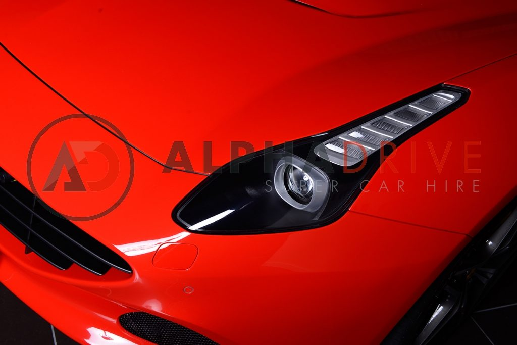 Ferrari red front lights car hire