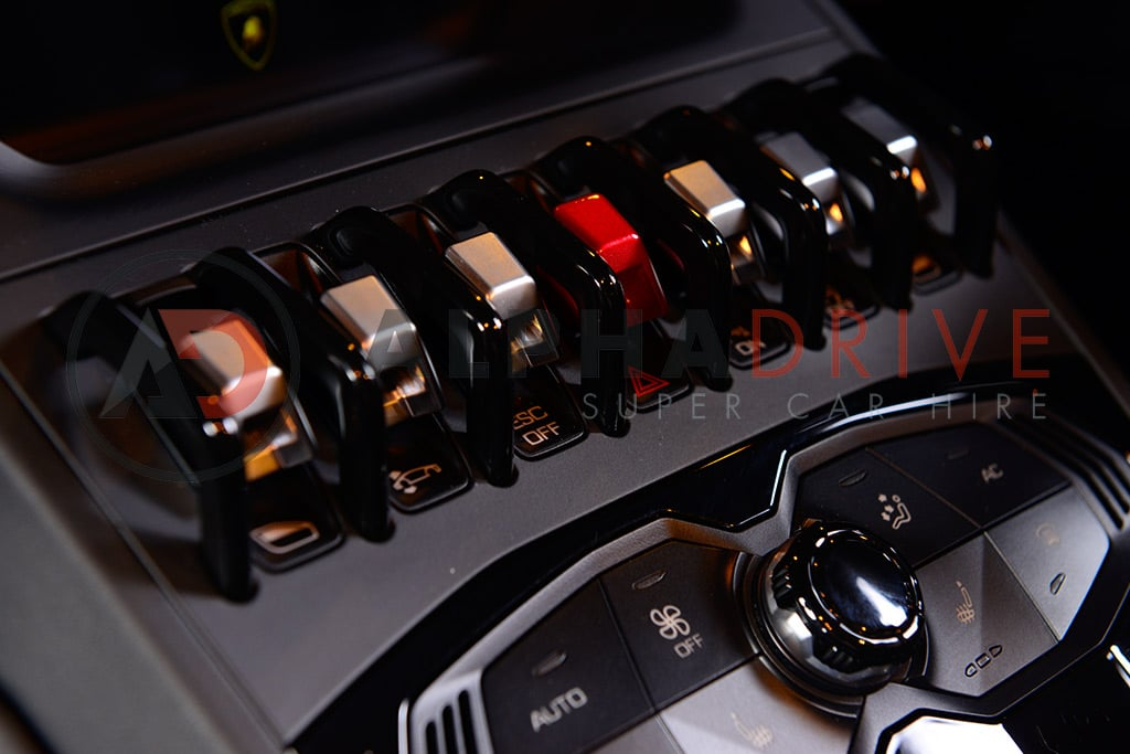 Switches inside Lamborghini car hire